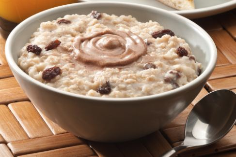 Oatmeal with raisins and a swirl of butter